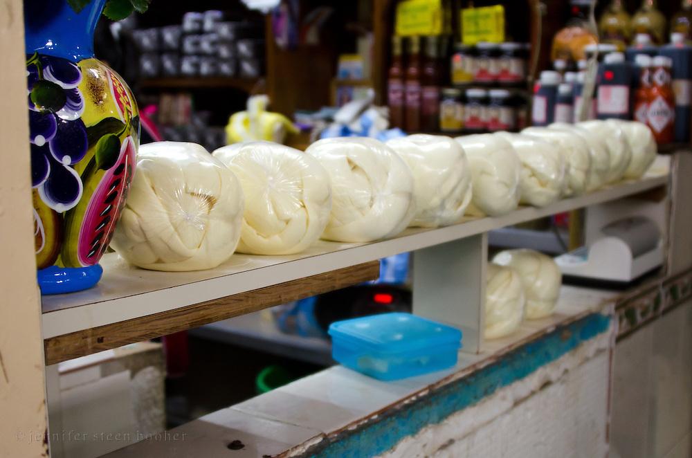 A row of Oaxacan 'quesilla', a kind of string cheese, in the Mercado Benito Juarez.