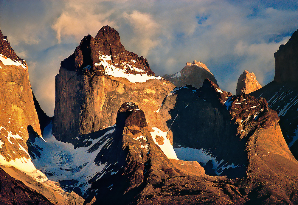 Early morning light warms the granite spires of the Cuernos del Paine, in Chile's Torres del Paine National Park.