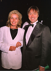 MR & MRS DAVID LLOYD he is the British Davis Cup captain and founder of the David Lloyd Leisure centres, at a dinner in London on 19th May 1998.MHS 96