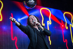 © Licensed to London News Pictures . 08/08/2015 . Siddington , UK . STEVE AUGERI on stage at The Rewind Festival of 1980s music , fashion culture at Capesthorne Hall in Macclesfield . Photo credit: Joel Goodman/LNP