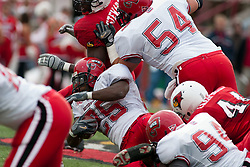 08 Oct 2005 Despite the attempts from is team mates, Lerron  Moore is leg dropped by Niall Campbell. The Illinois State University Redbirds roped and tied the Western Kentucky University Hilltoppers in regulation but loosened the noose in Overtime as the Hilltoppers take the honors with a 37 - 24 Victory in Gateway Conference action at Hancock Stadium on Illinois State's campus in Normal IL.