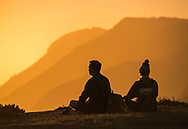 Couple meditating at sunset at the headlands of Point Reyes National Seashore, Marin County, California