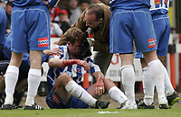 Hartlepool's Micky Barron receives treatment for a head injury before being stretchered off.