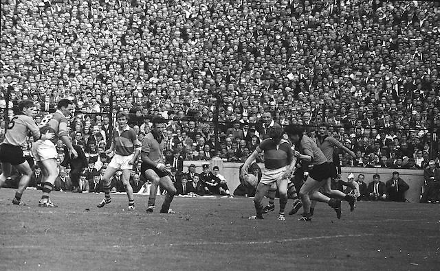 Kerry tries to protect the ball against Down attackers during the All Ireland Senior Gaelic Football Final Kerry v Down in Croke Park on the 22nd September 1968. Down 2-12 Kerry 1-13.