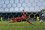 Brighton goalkeeper, David Stockdale (13) dives but cannot prevent the ball going in during the Sky Bet Championship Play Off First Leg match between Sheffield Wednesday and Brighton and Hove Albion at Hillsborough, Sheffield, England on 13 May 2016.