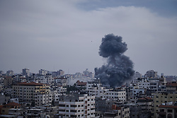 May 5, 2019 - Gaza, Palestine - Smoke and flames rose after an Israeli air raid on homes in Gaza City during the conflict between the Palestinians and the Israeli army that began two days ago. (Credit Image: © Mohamed Zarandah/SOPA Images via ZUMA Wire)