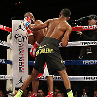 "IBF Junior Lightweight Champion Argenis ""La Tormenta"" Mendez (red trunks) fights against number one contender Rances ""Kid Blast"" Barthelemy  during the ""Judgement Day"" boxing event at American Airlines Arena on Thursday, July 10, 2014 in Miami, Florida.  Barthelemy won the fight after 12 rounds. (AP Photo/Alex Menendez)"