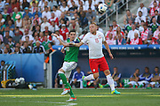 Northern Ireland Kyle Lafferty battles in the air with Poland Kamil Glik during the Euro 2016 match between Poland and Northern Ireland at the Stade de Nice, Nice, France on 12 June 2016. Photo by Phil Duncan.
