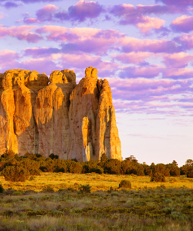 0207-1000 ~ Copyright: George H. H. Huey ~ Inscription Rock at sunrise. Site of permanent water used in prehistoric times [Anasazi culture], and historic times. Travelers left inscription at base of the rock. El Morro National Monument, New Mexico.