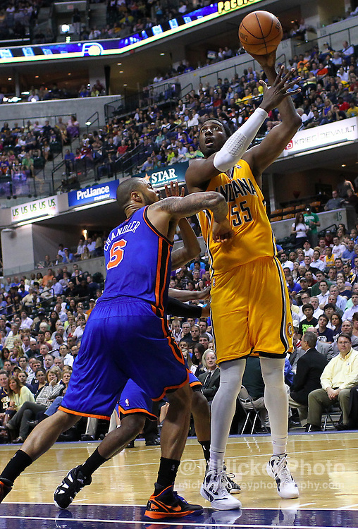 April 03, 2012; Indianapolis, IN, USA; Indiana Pacers center Roy Hibbert (55) shoots the ball over New York Knicks center Tyson Chandler (6) at Bankers Life Fieldhouse. Mandatory credit: Michael Hickey-US PRESSWIRE
