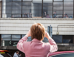 First Minister of Scotland and leader of the SNP Nicola Sturgeon, out on the election trail to make sure people are out voting today, May 7, 2015 in Glasgow, Scotland. Peoople at work opp Calton polling station.