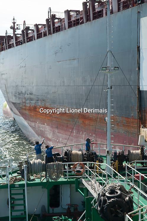 A Seven Seas refueling ship on its way to South Lamma island to refuel a Hapag Lloyd cargo ship.