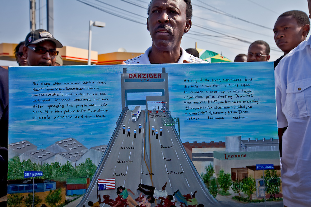 Pastor Lenord Lucas holding a painting of the crime that took place on the Danziger Bridge in New Orleans at a memorial march held in honor of James Brissette and  Ronald Madison who were killed on the bridge by a group of police who became to be known as the Danziger seven.  The New Orleans police involved coordinated a cover-up story for their crime, falsely reporting that seven police officers responded to a police dispatch reporting an officer down, and that at least four people were firing weapons at the officers upon their arrival.  U.S. Attorney Jim Letten working with the Civil Rights Division of the U.S. Department of Justice and the FBI are investigated the case.