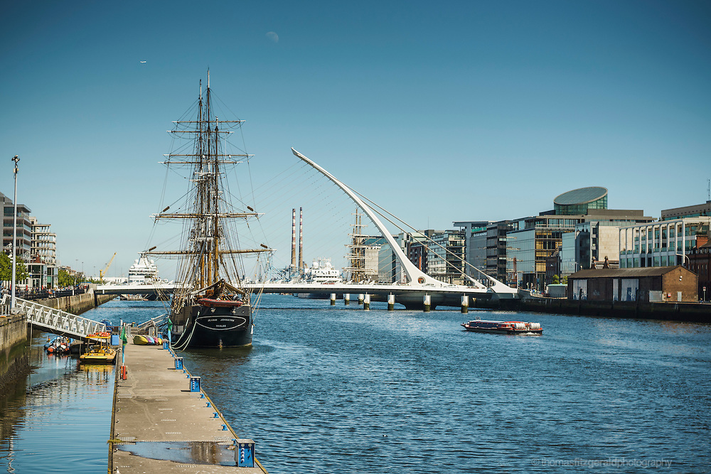 2013: Dublin, Ireland. The famous sailing training ship the Jeanie Johnston is docked by the side of the river Liffey with the Beckett bridge in the background