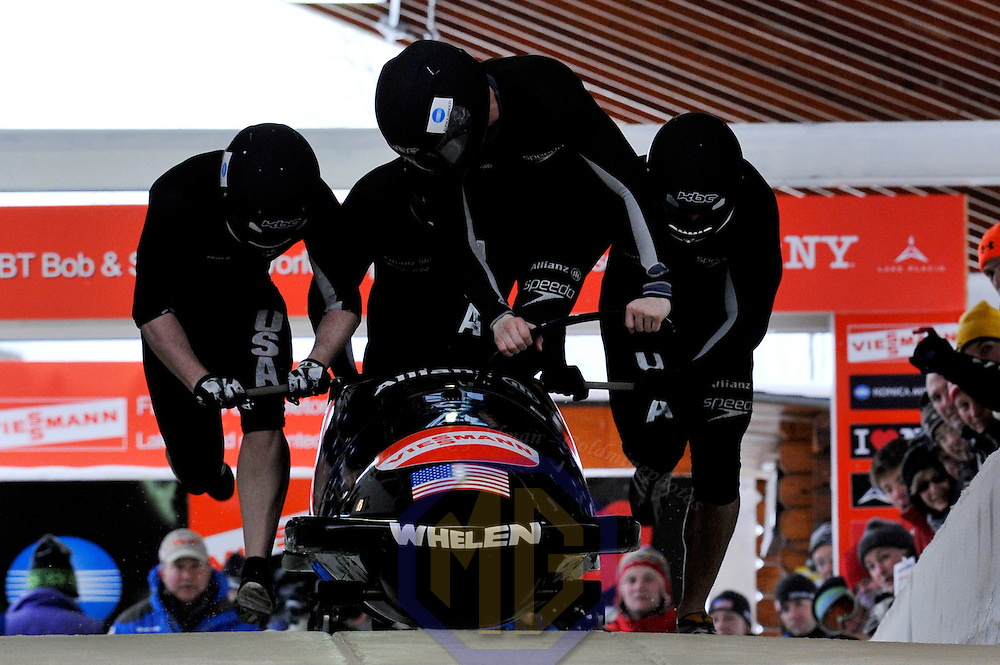16 December 2007:  The USA 2 sled driven by John Napier with Jamie Moriarty, T.J. Burns with brakeman Steven Langton compete at the FIBT World Cup 4-Man bobsled competition on December 16, 2007 at the Olympic Sports Complex in Lake Placid, NY.  The USA 2 sled finished in 8th place as the Russia 2 sled driven by Alexandr Zubkov won the race with a time of 1:48.79.