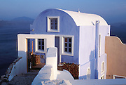 Oia, Santorini Island, Greece: a blue house looks out to the Aegean Sea.