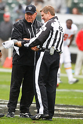 November 7, 2010; Oakland, CA, USA;  Oakland Raiders head coach Tom Cable meets with referee Jeff Triplette (42) before the game against the Kansas City Chiefs at Oakland-Alameda County Coliseum.