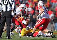 November 06 2010: Iowa State Cyclones quarterback Austen Arnaud (4) is brought down by Nebraska Cornhuskers defensive back DeJon Gomes (7) and Nebraska Cornhuskers defensive end Pierre Allen (95) as Nebraska Cornhuskers safety Austin Cassidy (8) closes in during the first half of the NCAA football game between the Nebraska Cornhuskers and the Iowa State Cyclones at Jack Trice Stadium in Ames, Iowa on Saturday November 6, 2010. Nebraska defeated Iowa State 31-30.