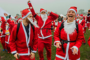 The warm up - Participants of all ages don Santa suits for the London Santa Dash on Clapham Common. The event was to raise money for the Great Ormond Street Hospital (GOSH) Children's Charity and involved a 5 or 10k run.