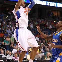 Mar 17, 2011; Tampa, FL, USA; Florida Gators forward Alex Tyus (23) shoots over UC Santa Barbara Gauchos forward James Nunnally (21) during first half of the second round of the 2011 NCAA men's basketball tournament at the St. Pete Times Forum.  Mandatory Credit: Derick E. Hingle