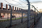 A barbed wire fence surrounding the Auschwitz Nazi concentration camp. It is estimated that between 1.1 and 1.5 million Jews, Poles, Roma and others were killed in Auschwitz during the Holocaust in between 1940-1945.