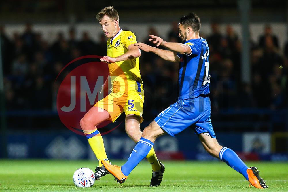 Tony Craig of Bristol Rovers goes past Jordan Williams of Rochdale - Mandatory by-line: Robbie Stephenson/JMP - 02/10/2018 - FOOTBALL - Crown Oil Arena - Rochdale, England - Rochdale v Bristol Rovers - Sky Bet League One