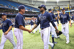 July 8, 2017 - St. Petersburg, Florida, U.S. - WILL VRAGOVIC   |   Times.Tampa Bay Rays pitching coach Jim Hickey (48) shakes hands with relief pitcher Alex Colome (37) after the game between the Boston Red Sox and the Tampa Bay Rays at Tropicana Field in St. Petersburg, Fla. on Saturday, July 8, 2017. The Tampa Bay Rays beat the Boston Red Sox 1-0. (Credit Image: © Will Vragovic/Tampa Bay Times via ZUMA Wire)