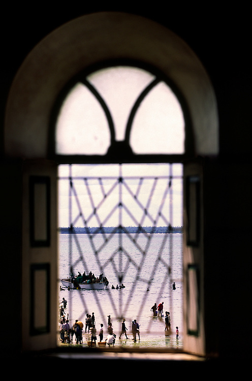 Fishermen arriving seen through one of the Great Mosque windows in Ilha de Mozambique