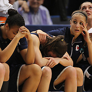 Stefanie Dolson (centre) and her Connecticut team mates on the bench after their two point loss during the Connecticut V Notre Dame Final match won by Notre Dame 61-59 during the Big East Conference, 2013 Women's Basketball Championships at the XL Center, Hartford, Connecticut, USA. 11th March. Photo Tim Clayton
