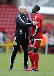 Barnsley Manger, David Flitcroft  with Bristol City's Albert Adomah - Photo mandatory by-line: Joe Meredith/JMP - Tel: Mobile: 07966 386802 23/02/2013 - SPORT - FOOTBALL - Ashton Gate - Bristol -  Bristol City V Barnsley - Npower Championship