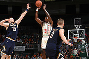 January 12, 2017: Anthony Lawrence, Jr. #3 of Miami shoots over Martinas Geben #23 of Notre Dame during the NCAA basketball game between the Miami Hurricanes and the Notre Dame Fighting Irish in Coral Gables, Florida. The Irish defeated the 'Canes 67-62.