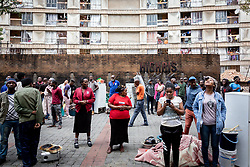 JOHANNESBURG, April 17, 2020  People gather outside a building due to a fire accident in Johannesburg, South Africa, April 16, 2020..  South Africa's COVID-19 deaths jumped by 14 in 24 hours as the novel coronavirus sickened 99 more people, Health Minister Zweli Mkhize said on Thursday. .  The total number of COVID-19 cases in the country has reached 2,605, the minister said. (Photo by YeshielXinhua) (Credit Image: © Xinhua via ZUMA Wire)