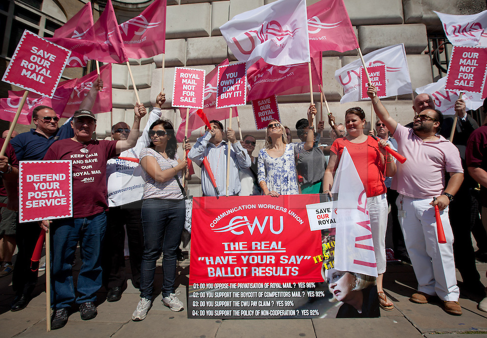 © Licensed to London News Pictures. 10/07/2013. London, UK. Postal workers and campaigners from the Communication Workers Union protest outside the Royal Mail headquarters with a large postcard to be delivered to bosses campaigning against privatisation of Royal Mail in London today (10/07/2013). Photo credit: Matt Cetti-Roberts/LNP