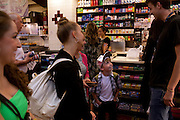 New York, NY - July 05, 2013 : Luke Spring, 10, center, laughs with a customer while buying lunch with his sisters Cami Spring, 20, left, Lucy Spring, 18, and mother Jill Spring during the New York City Dance Alliance National Summer Workshop held at the Sheraton New York Times Square Hotel in New York, NY on  July 05, 2013. Luke Spring, a dance prodigy from Studio Bleu Dance Center in Ashburn, VA, has performed on the Tonys, Ellen, So You Think You Can Dance and The Ford Gala. His sisters Cami Spring, 20, and Lucy Spring, 18, are both award winning dancers. (Photo by Melanie Burford/Prime for The Washington Post)