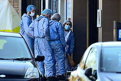 © Licensed to London News Pictures. 24/03/2019. LONDON, UK.  Forensics officers at an off licence at Marsh Road, Pinner, north west London, after being called at approximately 06:00hrs on 24 March to reports of a man found suffering injuries from a reported stabbing.  He was pronounced dead at the scene by officers and London Ambulance Service.  Enquiries are ongoing, no arrests have yet been made.  Photo credit: Stephen Chung/LNP
