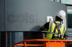 "© Licensed to London News Pictures; 15/06/2020; Bristol, UK. Signs and letters saying ""Colston Hall"" are removed from Bristol's largest music and entertainment venue over ongoing controversy with the name being associated with the 17th century slave trader Edward Colston. In 2017 Bristol Music Trust had said they would change the name when the hall was refurbished, but with continuing delays and the recent Black Lives Matters events the name removal has been brought forward, despite the new name not yet being announced. The name removal comes just over a week after the statue of Edward Colston which has stood in Bristol city centre for over 100 years was pulled down by protestors and thrown in Bristol Docks during a Black Lives Matters rally and march through the city centre. The rally was held in memory of George Floyd, a black man who was killed on May 25, 2020 in Minneapolis in the US by a white police officer kneeling on his neck for nearly 9 minutes. Edward Colston (1636 – 1721) was a wealthy Bristol-born English merchant involved in the slave trade, a Member of Parliament and a philanthropist. He supported and endowed schools, almshouses, hospitals and churches in Bristol, London and elsewhere, and his name is commemorated in several Bristol landmarks, streets, three schools and the Colston bun. The killing of George Floyd has seen widespread protests in the US, the UK and other countries against both modern day racism and historical legacies of slavery. Photo credit: Simon Chapman/LNP."