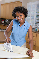 Mid-adult woman ironing