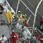 A horrific wreck of NASCAR driver Kyle Larson left his engine, wheel and various fence parts seated in the spectator grandstand area on the front stretch during a NASCAR Drive for COPD 300 race at Daytona International Speedway on Saturday, February 23, 2013 in Daytona Beach, Florida.  (Photo/Alex Menendez)