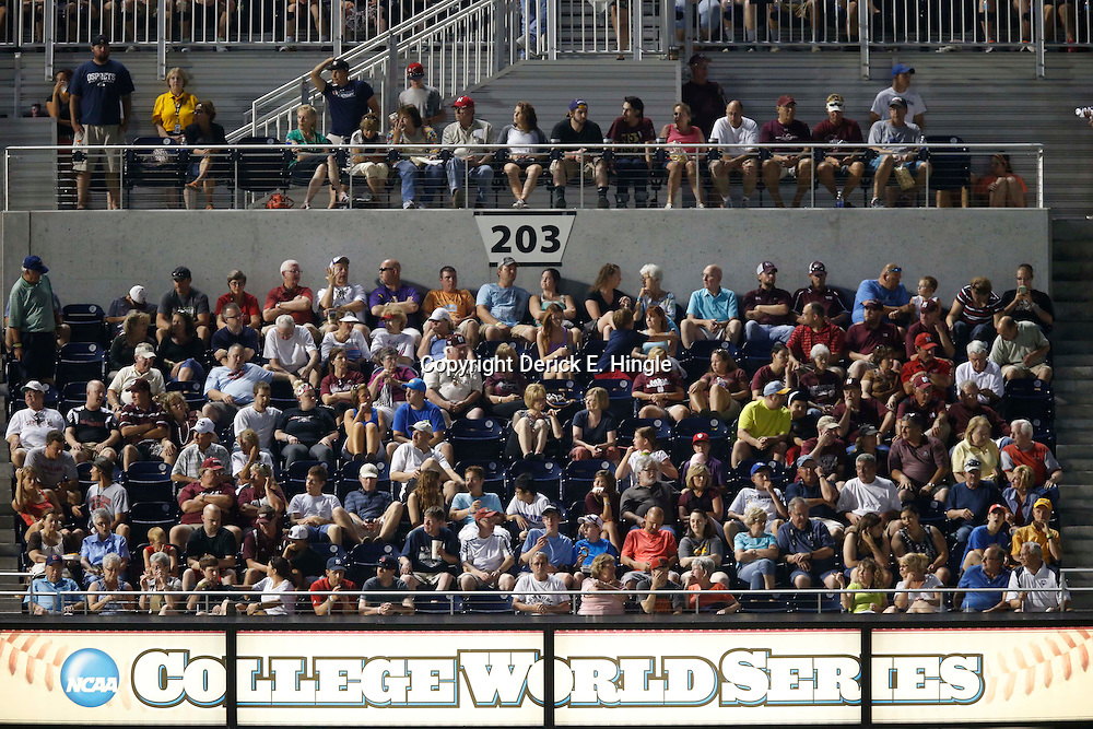 Jun 24, 2013; Omaha, NE, USA; Fans sit in the stands during the sixth inning in game 1 of the College World Series finals between the UCLA Bruins and the Mississippi State Bulldogs at TD Ameritrade Park. Mandatory Credit: Derick E. Hingle-USA TODAY Sports
