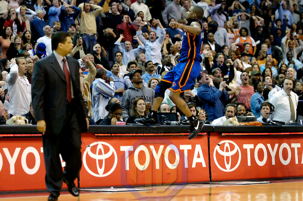 10 March 2007:    New York Knicks guard Steve Francis (R) climbs onto the scorers table and gestures to the crowd after making a game winning three-point shot with no time left against the Washington Wizards as head coach Eddie Jordan walks off the court at Verizon Center in Washington, D.C.  Francis finished with a game high 26 points as the Knicks defeated the Wizards 90-89.