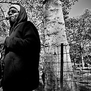 Performing his musical craft at the south entrance to Central Park on a fall afternoon.