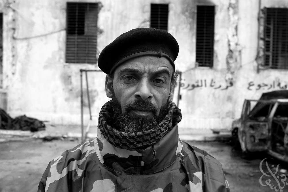 A Libyan soldier now loyal to the revolution poses for a portrait at the former internal security headquarters in Benghazi, Libya February 25, 2011. Soldiers in a number of Libyan units refused orders to fire on their countrymen, and have switched sides, joining the fight to topple Libyan leader Col. Muammar el-Qaddafi..Slug: Libya.Credit: Scott Nelson for the New York Times