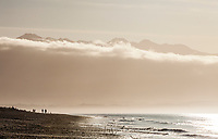 People walking the Dungeness spit on a sunny afternoon, Washington State, USA.