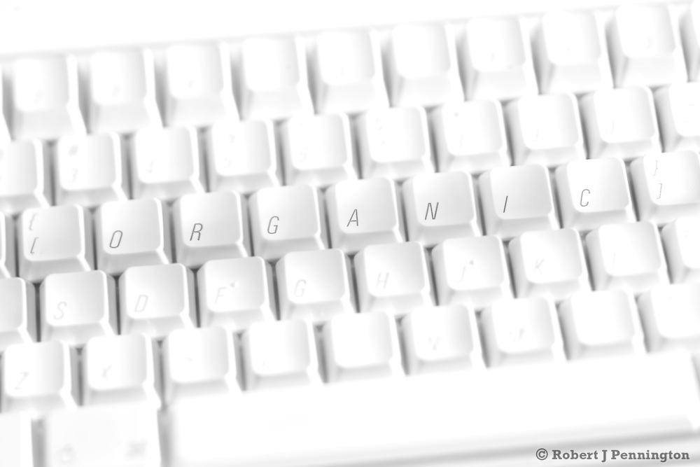 "White keyboard with the word ""Organic"" spelled out."