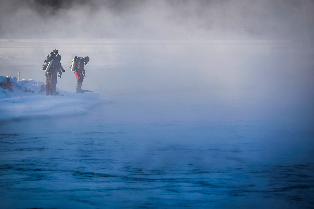 RCMP divers prepare to enter the Yukon River during a recovery effort for a man who was believed to have drowned earlier in the month.