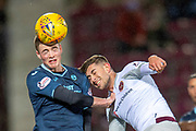 Lewis Mansell (#30) of Partick Thistle FC heads the ball ahead  of Marcus Godinho (#26) of Heart of Midlothian during William Hill Scottish Cup quarter final replay match between Heart of Midlothian and Partick Thistle at Tynecastle Stadium, Gorgie, Edinburgh Scotland on 12 March 2019.