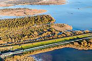 Nederland, Zuid-Holland, Hoeksche Waard, 07-02-2018; toerit en ingang tunnel van de HSL onder Dordtsche Kil. Hoeksche Waard. In de achtergrond spoorbruggen Hollandsch Diep.<br /> Entrance tunnel highspeed train, south of Rotterdam.<br /> <br /> luchtfoto (toeslag op standard tarieven);<br /> aerial photo (additional fee required);<br /> copyright foto/photo Siebe Swart