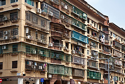 Laundry and security bars pepper most residential buildings in China's largest cities.  This apartment (condo) building in Macau is typical.