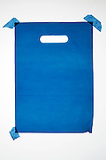 blue carry bag made from thick translucent plastic