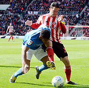Nathan Thompson and Bryan Oviedo go for the ball during the EFL Sky Bet League 1 match between Sunderland and Portsmouth at the Stadium Of Light, Sunderland, England on 27 April 2019.